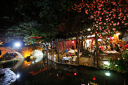 A picture made available on 05 April 2012 of a view of a restaurant by a water way in the Old Town of Lijiang in Yunnan Province, China, 04 April 2012. Designated a World Heritage site by UNESCO in 1997, the Old Town of Lijiang is famous for its unique architecture of the Naxi ethnic minority group and ancient waterways network. Rebuilt after being badly damaged in an earthquake in 1996, the picturesque old town is now a major tourist attraction housing a myriad of shops and bars catering to the hordes of tourists that descend on the town every year.