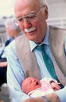 05 May 1997, Paris, France --- Grandfather Holding Newborn Granddaughter --- Image by © Owen Franken/CORBIS