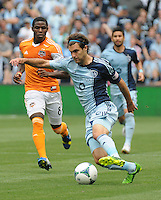 Football - Major League Soccer - Houston Dynamo at Sporting KC - The Sporting KC and the Houston Dynamo played to a 1-1 tie in regulation time at Sporting KC Park in Kansas City, Kansas, USA. Houston Dynamo defender Kofi Sarkodie (8, left) runs after Sporting KC midfielder/forward Graham Zusi (8) as he prepares to shoot in the first half..