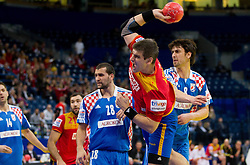 Julen Aguinagalde of Spain vs Marko Kopljar of Croatia during handball match between Croatia and Spain for 3rd place game at 10th EHF European Handball Championship Serbia 2012, on January 29, 2012 in Beogradska Arena, Belgrade, Serbia.  (Photo By Vid Ponikvar / Sportida.com)