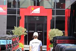 23.07.2015, Hungaroring, Budapest, HUN, FIA, Formel 1, Grand Prix von Ungarn, Vorberichte, im Bild Nico Rosberg (Mercedes AMG Petronas Formula One Team) von hinten zwischen Reifen rechts und links und Ferrari Motorhome Vor sich // during the preperation of the Hungarian Formula One Grand Prix at the Hungaroring in Budapest, Hungary on 2015/07/23. EXPA Pictures © 2015, PhotoCredit: EXPA/ Eibner-Pressefoto/ Bermel<br /> <br /> *****ATTENTION - OUT of GER*****