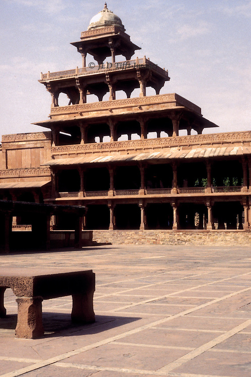 View across the main courtyard toward the Panch Mahal, or five storey palace, at Fatehpur Sikri, off the road between Agra and Jaipur, Uttar Pradesh, India. Founded in 1569 by the Mughal emperor Akbar, and served as the capital of the Mughal Empire from 1571 to 1585, when the city was abandoned for lack of water.