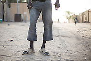 A man wears cut off jeans in Timbuktu as mandated by the town's extreme version of Sharia law on Jan. 30, 2013.