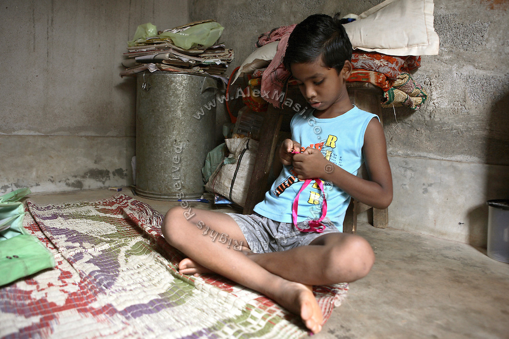 Budhia Singh, (right) 6, the famous Limca World Record marathoner, is looking at one of the medals he has won in the past while sitting in the house where they now live situated inside Salia Sahi slum (pop. 30.000) of Bhubaneswar, the capital of Orissa State, on Friday, May 16, 2008. On May 1, 2006, Budhia completed a record breaking 65 km run from Jagannath temple, Puri to Bhubaneswar. He was accompanied by his coach Biranchi Das and by the Central Reserve Police Force (CRPF). On 8th May 2006, a Government statement had ordered that he stopped running. The announcement came after doctors found the boy had high blood pressure and cardiological stress. As of 13th August 2007 Budhia's coach Biranchi Das was arrested by Indian police on suspicion of torture. Singh has accused his coach of beating him and withholding food. Das says Singh's family are making up charges as a result of a few petty rows. On April 13, Biranchi Das was shot dead in Bhubaneswar, in what is believed to be an event unconnected with Budhia, although the police is investigating the case and has made an arrest, a local goon named Raja Archary, which is now in police custody. **Italy and China Out**