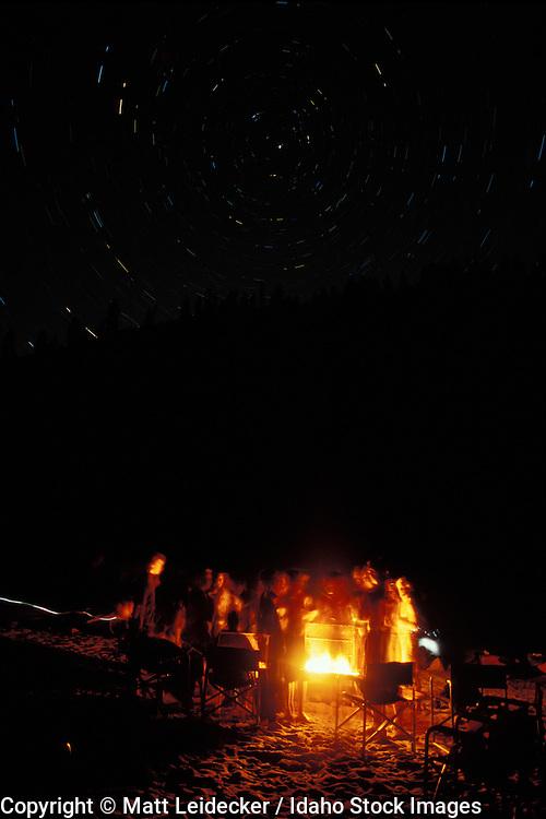 Idaho, main Salmon River.  Fire side gathering at night.