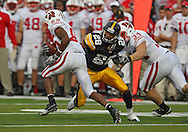 October 23 2010: Wisconsin Badgers wide receiver David Gilreath (85) tries to avoid Iowa Hawkeyes cornerback Shaun Prater (28) during the first half of the NCAA football game between the Wisconsin Badgers and the Iowa Hawkeyes at Kinnick Stadium in Iowa City, Iowa on Saturday October 23, 2010. Wisconsin defeated Iowa 31-30.