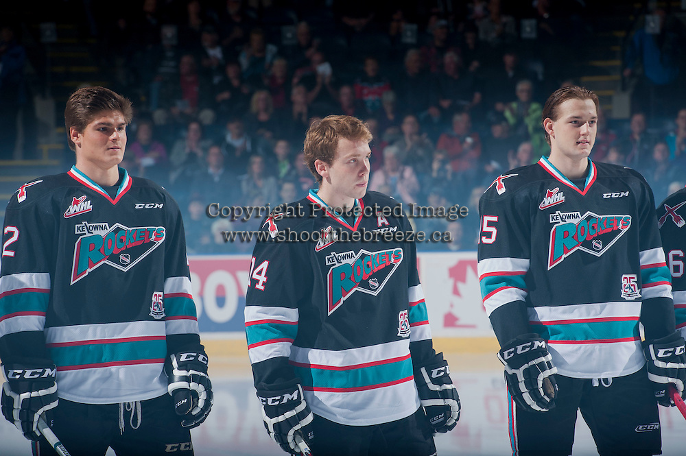 KELOWNA, CANADA - SEPTEMBER 25: Alexander Uryga #12, Rourke Chartier #14 and Tomas Soustal #15 of Kelowna Rockets line up for the season home opener against the Kamloops Blazers on September 25, 2015 at Prospera Place in Kelowna, British Columbia, Canada.  (Photo by Marissa Baecker/Shoot the Breeze)  *** Local Caption *** Alexander Uryga; Rourke Chartier; Tomas Soustal;