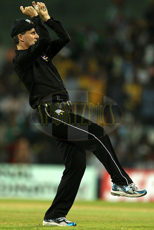 Umpire Billy Bowden signals a six during match 3 of the NOKIA Champions League T20 ( CLT20 )between the Chennai Superkings and the Mumbai Indians held at the M. A. Chidambaram Stadium in Chennai , Tamil Nadu, India on the 24th September 2011..Photo by Ron Gaunt/BCCI/SPORTZPICS