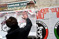 Roma 24 Marzo 2012.Conferenza stampa ai Magazzini popolari e corteo antifascista a Casalbertone dopo l'aggressione  di ieri da parte di militanti di Casa Pound..I manifesti di Casa Pound vengono coperti da manifesti dei centri sociali