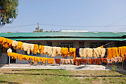 Freshly dyed cloth hanging out to dry at Womens Skills Development Project in Pokhara, Nepal. The WSDP was set up in 1975 as a non-profit, fair trade organization to help disadvantaged women in Nepal.
