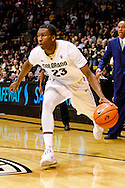 November 16th, 2013:  Colorado Buffaloes freshman guard Jaron Hopkins (23) drives towards the hoop in the first half of action in the NCAA Basketball game between the Jackson State Tigers and the University of Colorado Buffaloes at the Coors Events Center in Boulder, Colorado