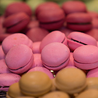 Stack of colorful macaroon in a market.