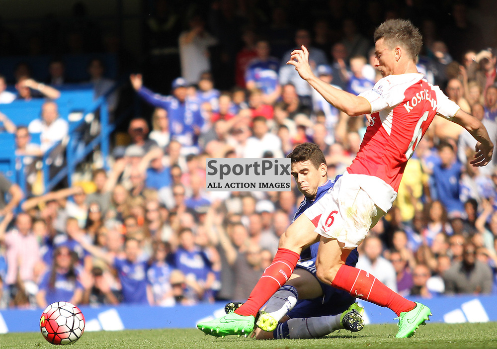 Laurent Koscielny is fouled by Oscar during the teams match at Stamford Bridge