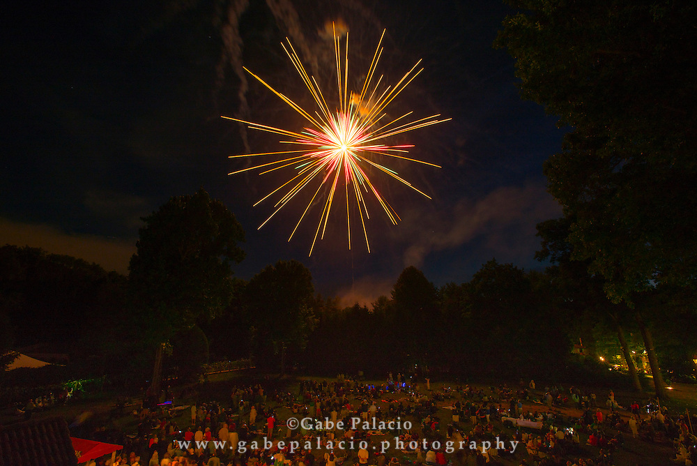 Fireworks above Friends Field at Caramoor in Katonah New York on July 2, 2016 for the Pops, Patriots, &amp; Fireworks, An Independence Day Celebration. <br /> (photo by Gabe Palacio)