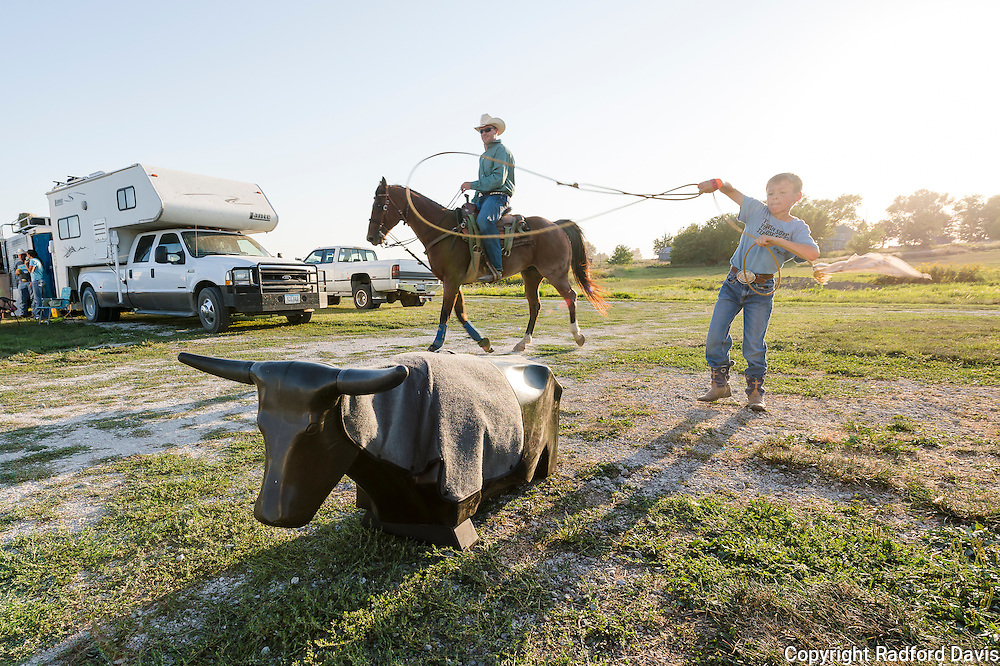 Dawson throws the rope toward a calf dummy. At 10 years old, he competes in break away calf roping, like his two brothers.