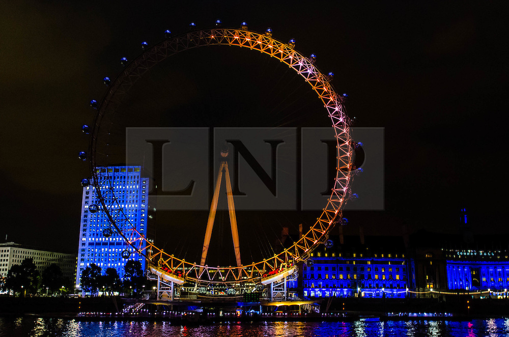 © Licensed to London News Pictures. 19/07/2012. London,UK.  London Eye Light Show.  The London Eye is illuminated 62% around its circumference, symbolising the 62% positivity of the nation towards the Olympics with one week to go.  EYE ON THE GAMES: Daley Thompson kicks off the world's first social media driven light show at the EDF Energy London Eye, powered by the UK's tweets on London 2012. The first EDF Energy of the Nation result reveals the nation is 62% positive about the Games with a week to go.    www.edfenergyofthenation.com  . Photo credit : Richard Isaac/LNP