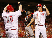 Thursday, April 18, 2013 REDS SPORTS : Cincinnati Reds guest bat boy Teddy Kremer and right fielder Jay Bruce (32) celebrate after scoring in the in the sixth inning on a Todd Frazier home run against the Miami Marlins at Great American Ball Park. The Enquirer/Jeff Swinger