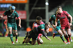 Scarlets replacement, Lewis Rawlins tackles Leicester Tigers full back, Mathew Tait - Photo mandatory by-line: Dougie Allward/JMP - Mobile: 07966 386802 - 16/01/2015 - SPORT - Rugby - Leicester - Welford Road - Leicester Tigers v Scarlets - European Rugby Champions Cup