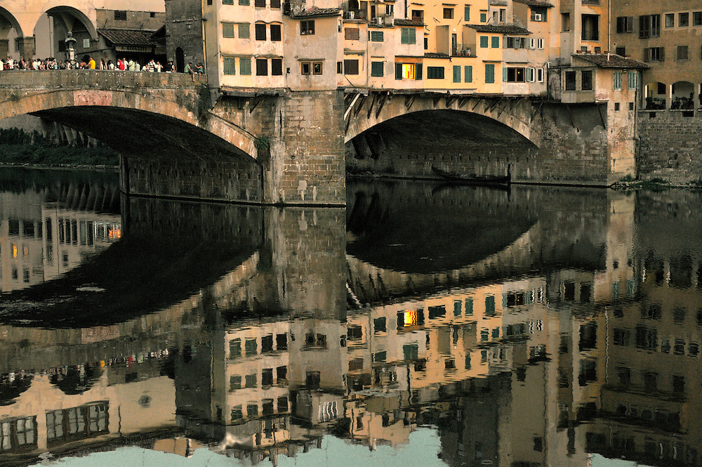 Florence, Tuscany, Italy. The Ponte Vecchio old bridge across the River Arno in the heart of the mediaeval renaissance city