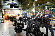 Workers assemble a truck chassis at the Daimler plant in Gaston Conty, NC   October 2017