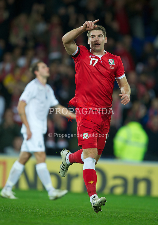 CARDIFF, WALES - Saturday, November 12, 2011: Wales' Sam Vokes celebrates scoring the fourth goal against Norway during the international friendly match at the Cardiff City Stadium. (Pic by David Rawcliffe/Propaganda)