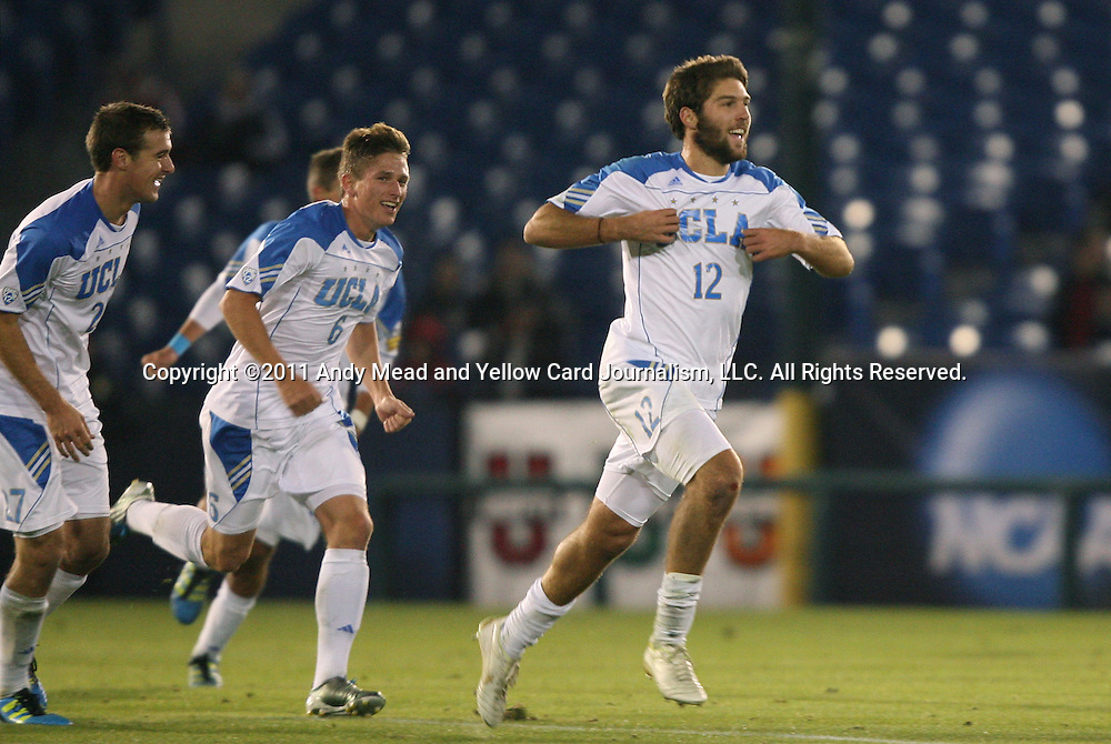 09 December 2011: UCLA's Ryan Hollingshead (12) celebrates his goal with Matt Wiet (6) and Joe Sofia (27). The University of California Los Angeles Bruins played the University of North Carolina Tar Heels to a 2-2 tie after overtime, with the Tar Heels advancing with a 3-1 win in the penalty kick shootout at Regions Park in Hoover, Alabama in an NCAA Division I Men's Soccer College Cup semifinal game.