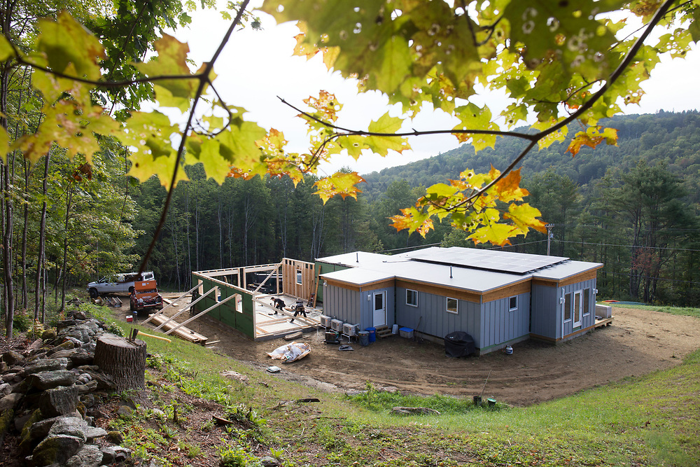 Carpenters Tyler Wheatley and Ben Parsons of Conniff's Custom Building in Brookfield, Vt., build a garage on-site after a Vermod home was placed on the property in Woodstock, Vt., on Aug. 30, 2017. Doc Conniff said he has been working with Vermod Homes owner Steve Davis on jobs for 30 years. (Photo by Geoff Hansen)