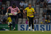 Gareth Berg tries to outrun Dawid Malan to field off his own bowlingduring the Vitality T20 Blast South Group match between Hampshire County Cricket Club and Middlesex County Cricket Club at the Ageas Bowl, Southampton, United Kingdom on 20 July 2018. Picture by Dave Vokes.