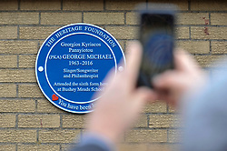 © Licensed to London News Pictures. 15/04/2018. BUSHEY, UK.  A fan photographs a blue plaque commemorating the life of singer George Michael which has been unveiled at Bushey Meads school in Bushey, north west London.  George Michael was a student at the school for two years prior to finding success with Andrew Ridgeley in the group Wham! before moving on to a successful solo career.   The blue plaque was made possible by the George Michael Appreciation Society and the Heritage Foundation.  Photo credit: Stephen Chung/LNP