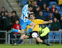 Photo: Scott Heavey.<br />Oxford United v Huddersfeild Town. Nationide Division Three. 06/03/2004.<br />James Hunt mis-times his tackle on Danny Schofield of Huddersfield