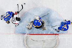 Go Tanaka of Japan vs Igor Karpenko of Ukraine during ice-hockey match between Japan and Ukraine at IIHF World Championship DIV. I Group A Slovenia 2012, on April 21, 2012 at SRC Stozice, Ljubljana, Slovenia. (Photo By Matic Klansek Velej / Sportida.com)