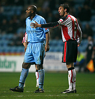 Dele Adebola of Coventry City (left) and Southampton captain Claus Lundekvam (right)