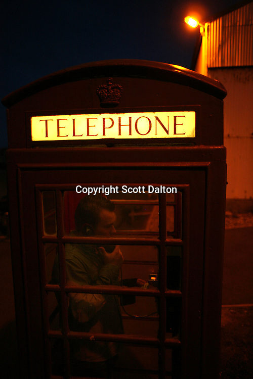 A service member of the British armed forces makes a call from a traditional English phone booth in Stanley, the capital of the Falkland Islands, on Saturday, March 17, 2007. This year is the 25 anniversary of the war for sovereignty of the islands between the United Kingdom and Argentina. The two-month war resulted in the withdrawal of Argentinean forces and the islands remained part of the United Kingdom. (Photo/Scott Dalton)