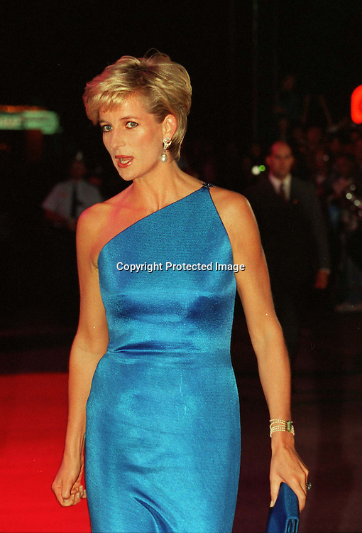 Diana, Princess of Wales. attends a benefit dinner in Sydney, Australia in October 1996.  The Princess is wearing a stunning turquoise silk dress caught on one shoulder by Versace.<br />