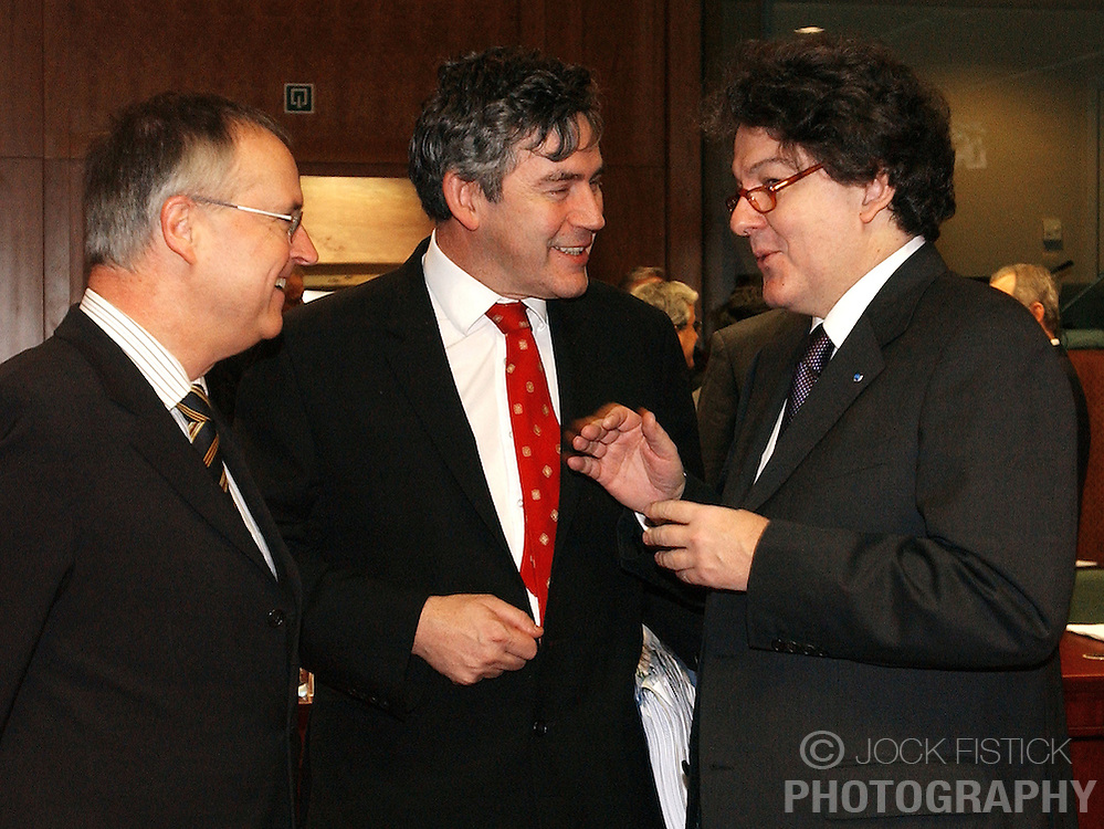 BRUSSELS, BELGIUM - MARCH-08-2005 - Gordon Brown, the UK's finance minister, center, speaks with and Thierry Breton, France's finance minister, right, during Ecofin , the gathering of all the European Union economic and finance Ministers.
