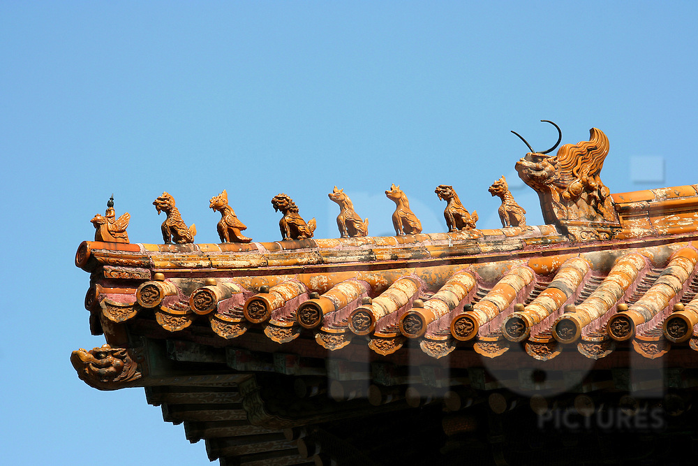 Details of a roof in forbidden city with small dragon's statue