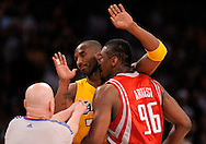 Houston's Ron Artest gets in the face of the Lakers' Kobe Bryant as referee Joey Crawford tries to separate the two during the Lakers' 11-98 victory to even the their playoff series one game apiece. Artest was ejected on the play....///ADDITIONAL INFO:  lakers.0507.kjs7.jpg  ---  Photo by Kevin Sullivan, The Orange County Register --  ..The Los Angeles Lakers take on the Houston Rockets in Game 2 of the Western Conference semifinals Wednesday May 6, 2009 at Staples Center..