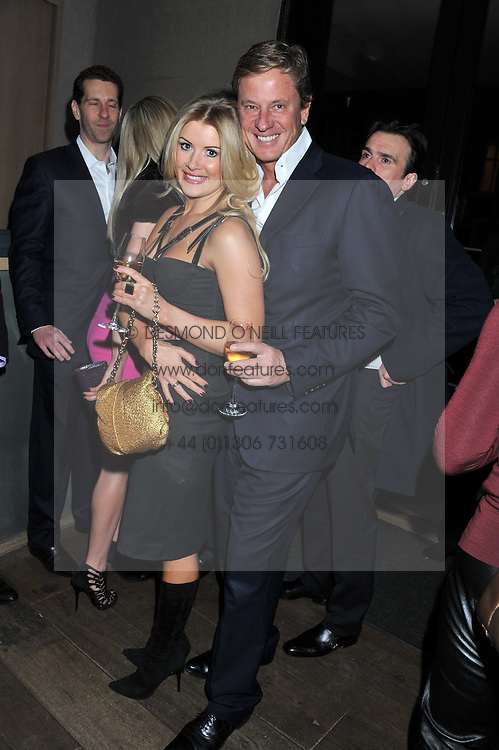 ROB & KATIE HERSOV at a dinner hosted by Marlon & Nadya Abela at Cassis 232-236 Brompton Road, London to thank customers & friends for their custom held on 9th February 2012.