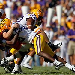 Oct 2, 2010; Baton Rouge, LA, USA; LSU Tigers defensive end Barkevious Mingo (49) forces a fumble by Tennessee Volunteers quarterback Matt Simms (2) during the second half at Tiger Stadium. LSU defeated Tennessee 16-14.  Mandatory Credit: Derick E. Hingle