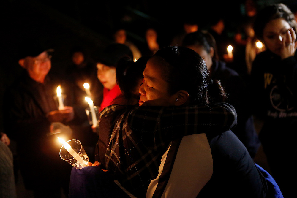 Walnut, CA - Monday, February 4, 2013: Jaemy Oda,  who knew Monica Quan since she was 5 years old, right, is hugged by Krista Nakano, left, as tears form in her eyes during a memorial vigil for Monica Quan at Walnut High School on Monday, February 4, 2013 in Walnut, Calif. Oda found out about Quan's death through her family members who told her at work in person because they knew her and Quan were so close. Keith Lawrence, 27, and Monica Quan were found shot to death in a parked car in an upscale Irvine condominium complex where the couple lived this morning. Shooting suspect CHRISTOPHER JORDAN DORNER, is a suspect in the shooting of two Riverside police officers this morning, and the shooting deaths of Keith Lawrence and Monica Quan Saturday.**RESTRICTIONS: LA, ORANGE COUNTY, VENTURA,<br />