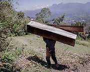 A family member disposes an old coffin.<br /> <br /> Ma'nene is a tradition that takes place in August after harvest where the bodies of the dead loved ones are exhumed to be cleaned, groomed and dressed. For most, it's a bittersweet moment, a chance to reunite and physically see and touch and reconnect with loved ones who had passed on.