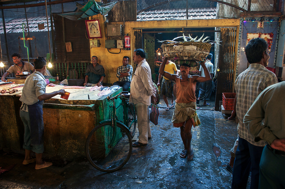 The fish section at New Market, or Hogg Market, is a hive of activity, especially at dawn. Rickshaw wallahs and traders, fish sellers and butchers mingle to get their business done early.