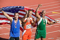 Three male athletes enjoying victory, portrait