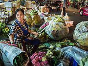 30 JUNE 2016 - BANGKOK, THAILAND:  Flower vendors on Thanon Chakphet in front of Pak Khlong Talat. Sidewalk vendors around Pak Khlong Talat, Bangkok's famous flower market, face eviction if they reopen on July 1. As a part of the military government sponsored initiative to clean up Bangkok, city officials have been trying to shut down the sidewalk vendors around the flower market. The vendors were supposed to be gone by the end of March, but city officials relented at the last minute with a compromise allowing vendors to stay until June 30. When vendors dismantled their booths after business on June 30, they weren't sure if they will be allowed to reopen July 1. Some vendors have moved to new locations approved by the government but many have not because they can't afford the higher rents in the new locations.    PHOTO BY JACK KURTZ