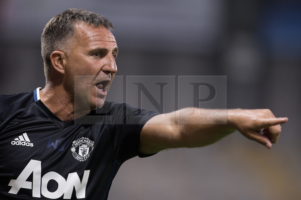 © Licensed to London News Pictures . 15/08/2016 . Leigh , UK . Manchester United Manager WARREN JOYCE . Manchester United vs Leicester City reserves at Leigh Sports Village Stadium . Photo credit : Joel Goodman/LNP
