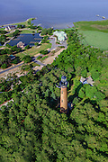 Aerial photograph of the Currituck Beach Lighthouse in Corolla North Carolina on the Outer Banks.