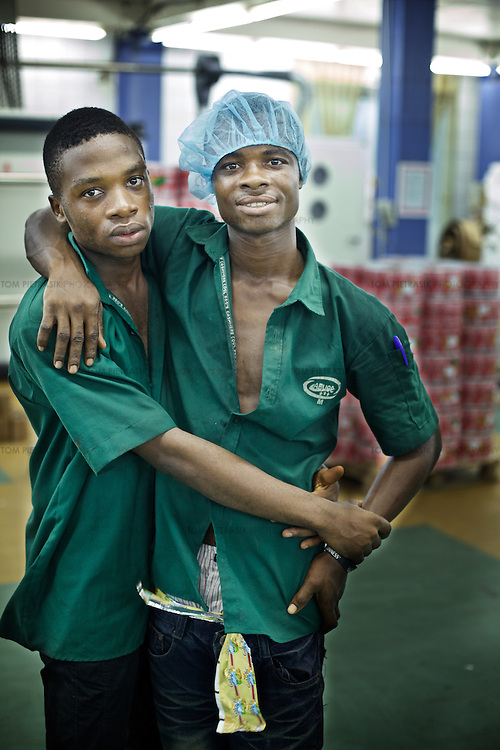 Workers at a factory producing plastic packaging and labelling for Nigerian and multinational companies. <br /> <br /> Photo: Tom Pietrasik.Ogun State, Nigeria. 2012