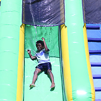 Isaiah Young, 6, slides down the waterslide Saturday at Veterans Park
