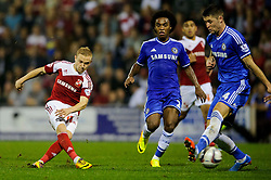 Swindon Forward Alex Pritchard (ENG) shoots past Chelsea Defender Gary Cahill (ENG) during the second half of the match - Photo mandatory by-line: Rogan Thomson/JMP - Tel: 07966 386802 - 24/09/2013 - SPORT - FOOTBALL - The County Ground - Swindon Town v Chelsea - Capital One Cup Round 3.