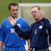 St Johnstone Training...06.08.04<br />Manager John Connolly giving instructions to captain David Hannah during training this morning.<br />see story by Gordon Bannerman Tel: 01738 553978 or 07729 865788<br />Picture by Graeme Hart.<br />Copyright Perthshire Picture Agency<br />Tel: 01738 623350  Mobile: 07990 594431